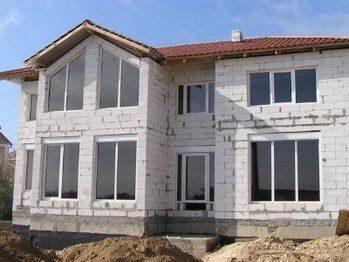 Фасады частных домов из штукатурки